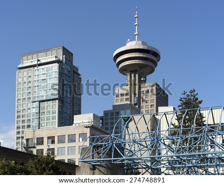 VANCOUVER - MAY 2, 2015: Harbour Centre, located on West Hastings Street was opened in 1997. It is one of tallest and most iconic landmarks of Metro Vancouver. British Columbia, Canada. - stock photo