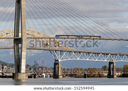 - stock-photo-vancouver-new-westminster-skytrain-bridge-above-fraser-river-152594945