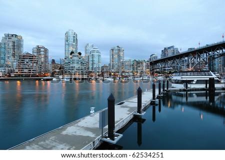 vancouver night scene of city from granville island, vancouver, british columbia, canada - stock photo