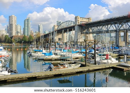 VANCOUVER - NOVEMBER 14, 2016: The Burrard Street Bridge spans False Creek and a large marina in Vancouver on November 14, 2016.