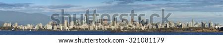 VANCOUVER, PANORAMIC - SEPTEMBER 26, 2015: Nestled under Coast Mountains and washed by Pacific, the most beautiful and the largest city of British Columbia is a home to 2.5 millions (Metro Vancouver)