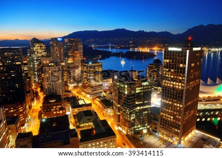 Vancouver rooftop view with urban architectures at dusk. - stock photo