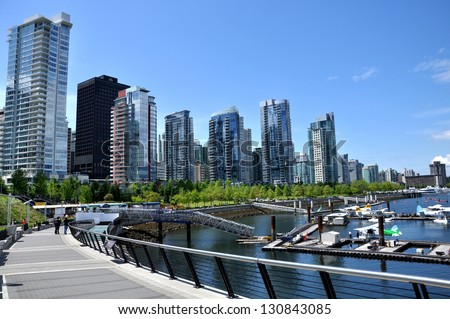 vancouver seawall and skyline near vancouver convention centre - stock photo