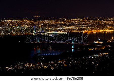 Vancouver Skyline and Lions Gate Bridge At Night - stock photo