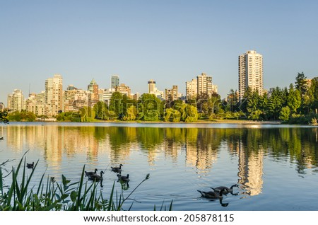 Vancouver Skyline and Reflection in Water at Sunset - stock photo