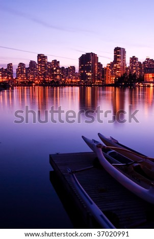 vancouver skyline and water, during twilight - stock photo