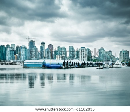 Vancouver skyline as seen from Stanley park - stock photo