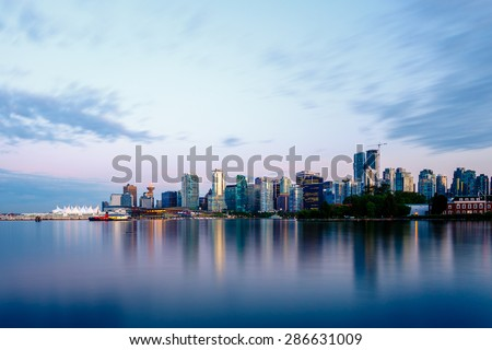 Vancouver skyline at sunset as seen from Stanley Park, British Columbia, Canada - stock photo