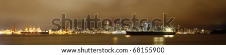 Vancouver Skyline with Moored Ship at Night - stock photo