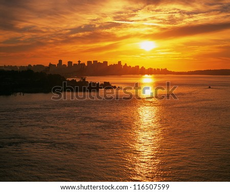 Vancouver - skyline with sunset and Burrard Inlet - stock photo