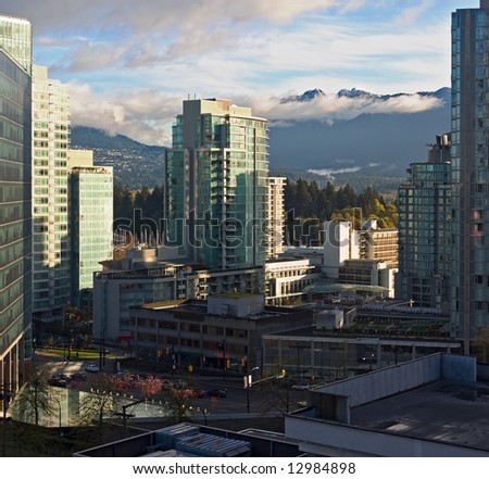 Vancouver - view at the city's condominiums towards Stanley Park and the mountains, taken early in the morning