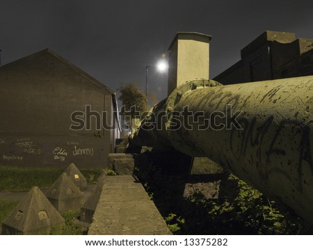 Vandalised Gas Pipe near Grass at Night in Manchester UK - stock photo