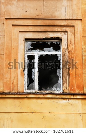 Vandals smashed the window of the police station - stock photo