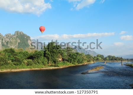 Vang Vieng  is a tourism-oriented town in Laos, located in Vientiane Province about four hours bus ride north of the capital. The town lies on the Nam Song river. - stock photo