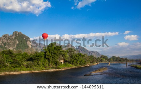 Vang Vieng is a tourism-oriented town in Laos, located in Vientiane Province about four hours bus ride north of the capital. The town lies on the Nam Song river - stock photo
