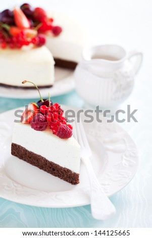 Vanilla and chocolate cheesecake with berries, selective focus - stock photo