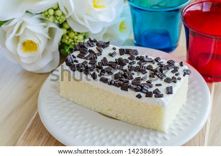Vanilla Cake in white dish on the wood table - stock photo