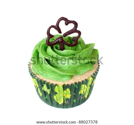 Vanilla cupcake, decorated for St. Patrick's day celebration. - stock photo