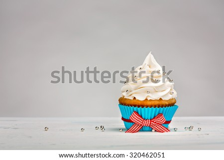 Vanilla Cupcake with buttercream icing  - stock photo