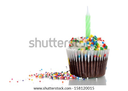vanilla cupcake with sprinkles isolated white background - stock photo