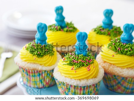 Vanilla cupcakes with yellow buttercream decorated for Easter - stock photo