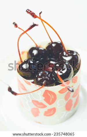 vanilla dessert with cherry confiture. Warm colors. Shallow dof.  - stock photo