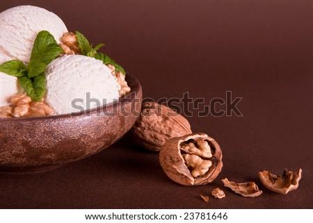 Vanilla ice cream bowl with fresh walnuts - stock photo