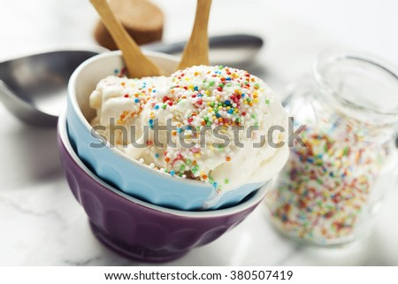 Vanilla ice cream in bowl with colorful sprinkles