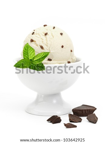 Vanilla ice cream in bowl with mint on white background