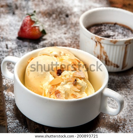 vanilla ice cream in white cup with hot chocolate