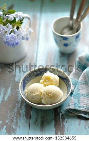 Vanilla Ice Cream on a blue or cyan background in a blue bowl