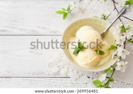 Vanilla ice cream on wooden background