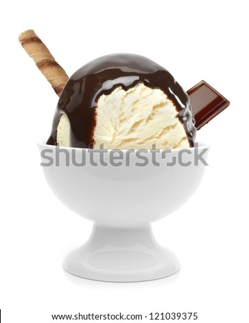 Vanilla ice cream with chocolate sauce and wafer in bowl - stock photo