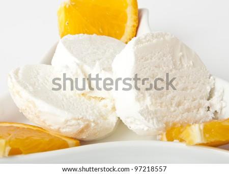 Vanilla ice cream with orange slices - stock photo