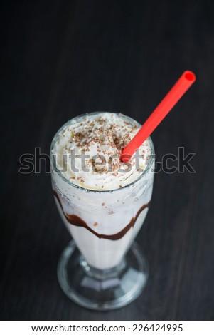 vanilla milkshake on black background - stock photo