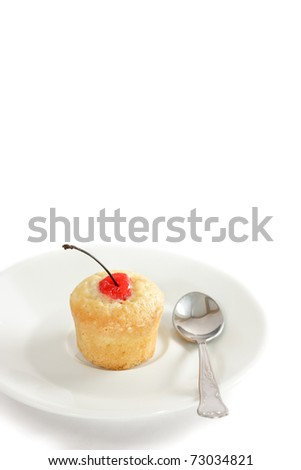 Vanilla muffin with a cherry.