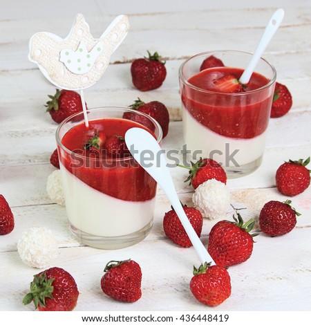 Vanilla panna cotta with berry sauce - stock photo