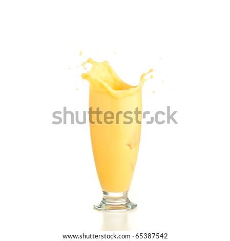 vanilla shake splash on a white background - stock photo