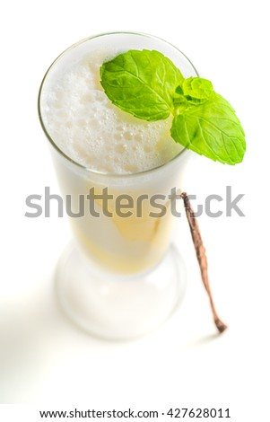 Vanilla smoothies with mint leaf on white background