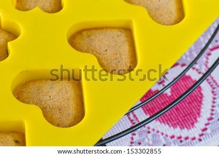Vanilla  sponge cake hearts in yellow silicone mold - stock photo