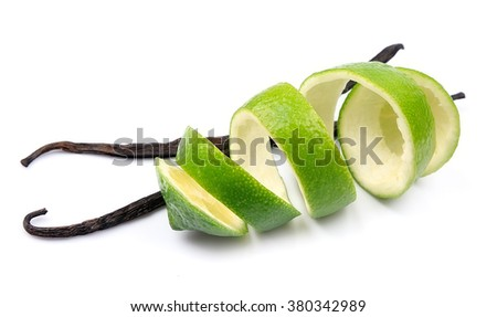 Vanilla sticks and limes spiral on white isolated
