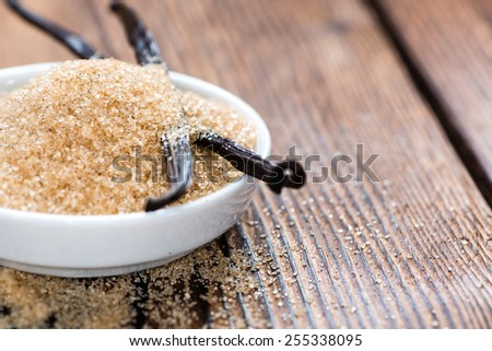 Vanilla Sugar (Brown) on wooden background (close-up shot) - stock photo