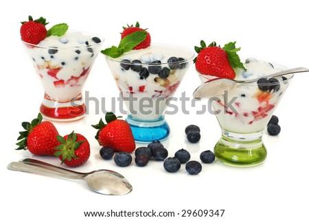 Vanilla yogurt over strawberries, banana and blueberries isolated on white. - stock photo