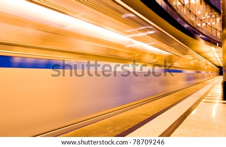 vanishing moving orange train - stock photo