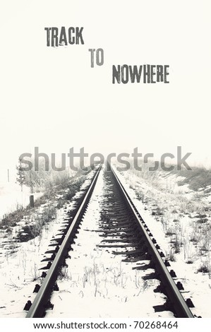 vanishing railroad in winter. track to nowhere - stock photo
