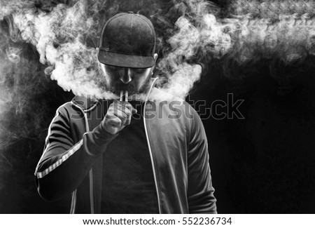 vaping man holding mod cloud vapor stock photo royalty free 552236734 shutterstock