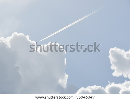 Vapor Trail and Clouds - stock photo