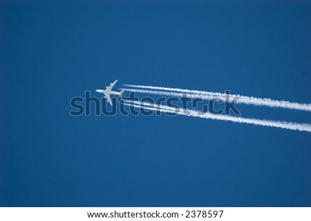 vapor trail from an airplane - stock photo