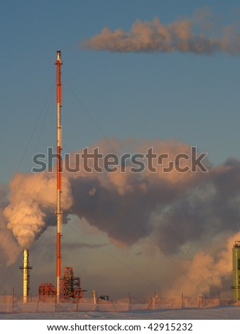 vapors flood the blue Alberta sky from a petrochemical refinery near Edmonton, Alberta, Canada - stock photo