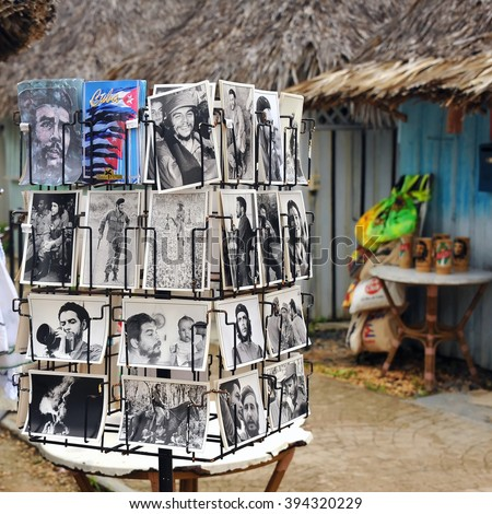 VARADERO, CUBA - JANUARY 16, 2016:  Rack at tourist shop in resort holds several postcards featuring Che Guevara, Fidel Castro and other revolutionary themes. - stock photo